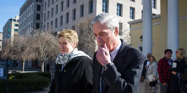 Special Counsel Robert Mueller, and his wife, Ann, leaving St. John's Episcopal Church, across from the White House, in Washington on Sunday. (AP Photo/Cliff Owen)