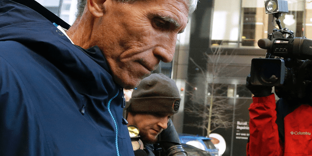 """William """"Rick"""" Singer founder of the Edge College & Career Network, departs federal court in Boston on Tuesday, March 12, 2019, after he pleaded guilty to charges in a nationwide college admissions bribery scandal. (AP)"""