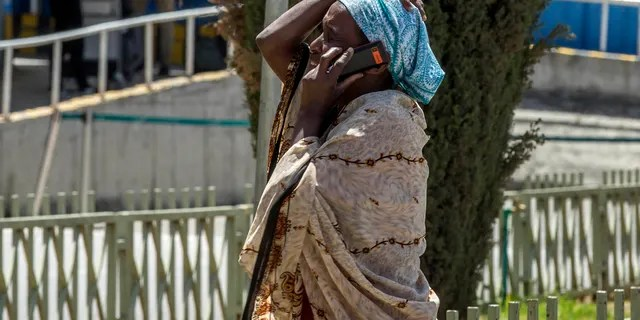 A family member of a victim involved in a plane crash talks on a mobile phone at Addis Ababa international airport Sunday, March 10, 2019.