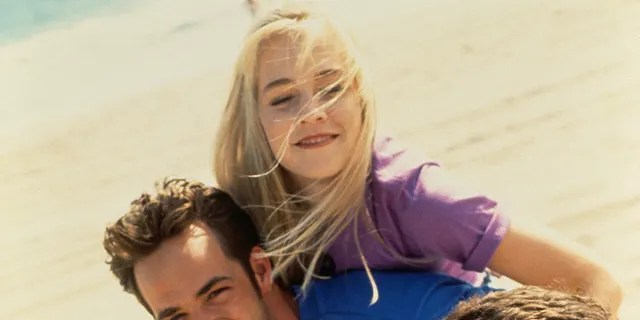 "Luke Perry, Jennie Garth, and Brian Austin Green of ""Beverly Hills, 90210"" in 1991."