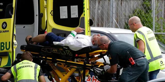 """Ambulance staff take a man from outside a mosque in central Christchurch, New Zealand, Friday, March 15, 2019. Multiple people were killed in mass shootings at two mosques full of worshippers attending Friday prayers on what the prime minister called """"one of New Zealand's darkest days,"""" as authorities detained four people and defused explosive devices in what appeared to be a carefully planned attack"""