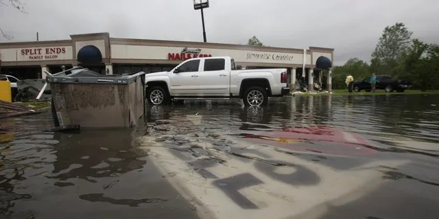 In the Pemberton Quarters Mall, on Saturday, April 13, 2019 in Vicksburg, Miss, rubble is scattered in flooded water after heavy weather.
