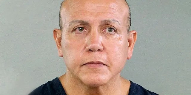 In this undated photo released by the Broward County Sheriff's office, Cesar Sayoc is seen in a booking photo, in Miami. Federal authorities took Sayoc, 56, of Aventura, Fla., into custody Friday, Oct. 26, 2018 in Florida in connection with the mail-bomb scare that earlier widened to 12 suspicious packages, the FBI and Justice Department said.