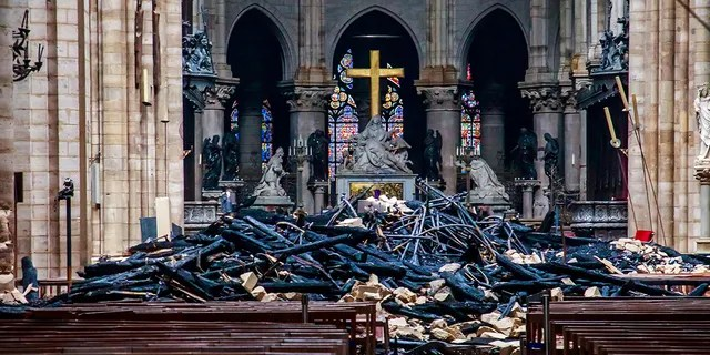 A view of the debris inside Notre-Dame de Paris in the aftermath of a fire that devastated the cathedral, during the visit of French Interior Minister Christophe Castaner (not pictured) in Paris, France, April 16, 2019. Christophe Petit Tesson/Pool via REUTERS - RC12F77ABC70