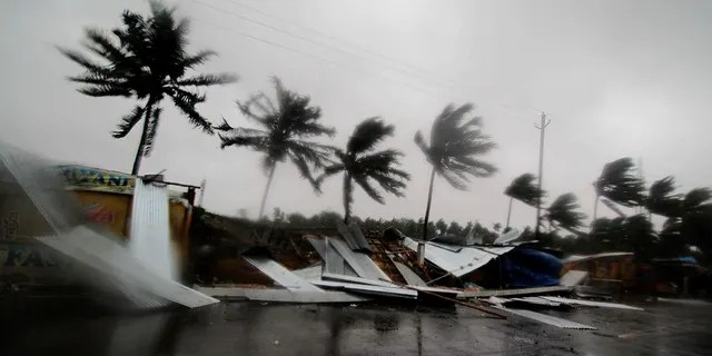 Street shops are seen collapsed due to gusty winds preceding the landfall of cyclone Fani on the outskirts of Puri, in the Indian state of Odisha. (AP Photo)