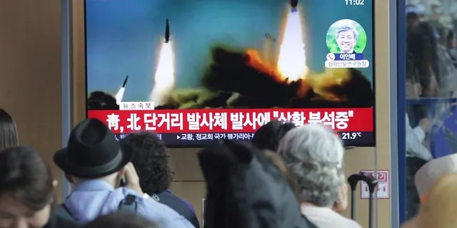 People watch a TV showing footage of North Korea's missile launch during a news program at the Seoul Railway Station in Seoul, South Korea on Saturday. (AP Photo/Ahn Young-joo)