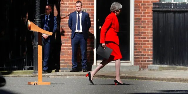 Britain's Prime Minister Theresa May walks back after addressing the media in Downing Street in London, Friday, May 24. May has announced that will step down as U.K. Conservative Party leader on June 7, sparking a contest to become Britain's next prime minister.