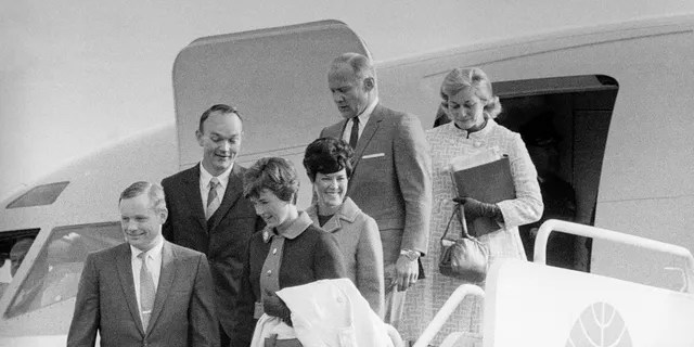 File photo - The Apollo 11 astronauts and their wives leaving the Presidential aircraft at Heathrow Airport in London during their