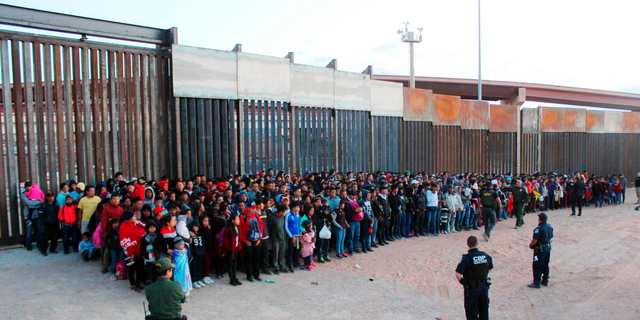 This May 29 photo released by U.S. Customs and Border Protection showed some of 1,036 migrants who crossed the U.S.-Mexico border in El Paso, Texas, the largest that the Border Patrol says it has ever encountered. (U.S. Customs and Border Protection via AP)