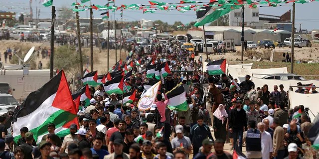 Palestinians attend a protest by the Israeli border with Gaza Strip, Wednesday, May 15, 2019.