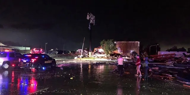People look over heavy tornado damage in El Reno, Okla., on Saturday night. (FOX 25, Oklahoma City)