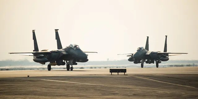 Two F-15E Strike Eagles from the 336th Fighter Squadron, 4th Fighter Wing at Seymour Johnson Air Force Base, North Carolina taxi the runway at Al Dhafra Air Base, United Arab Emirates, June 13, 2019. The F-15E's joined ADABs inventory of other fighters to include F-15C Eagles and F-35A Lightning IIs.