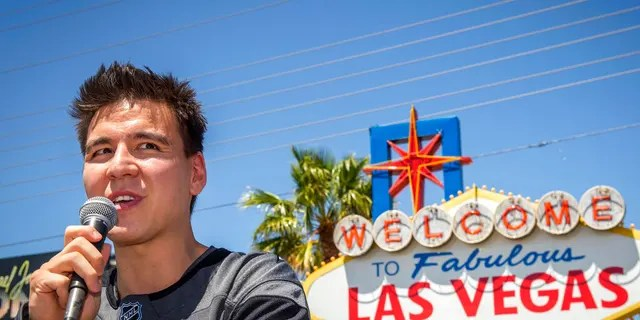"""FILE: """"Jeopardy!"""" sensation James Holzhauer speaks after being presented with a key to the Las Vegas Strip in front of the Welcome to Fabulous Las Vegas sign in Las Vegas."""