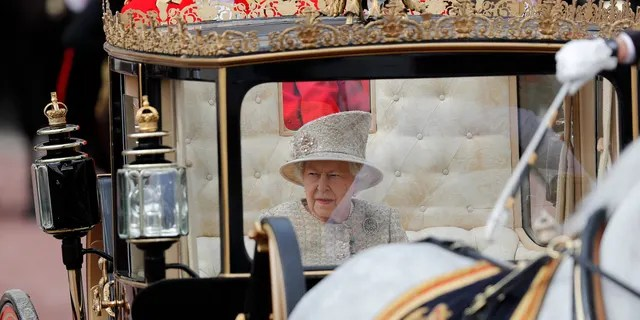 Britain's Queen Elizabeth rides in a carriage to attend the annual Trooping the Colour Ceremony in London, Saturday, June 8, 2019.