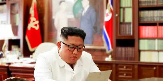 FILE: North Korean leader Kim Jong Un reads a letter from U.S. President Donald Trump.