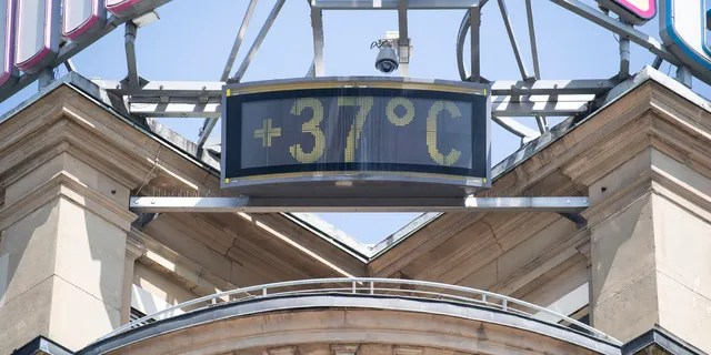 A sign shows 37 degrees Celsius at a building in the city of Stuttgart, Germany, Wednesday, June 26, 2019.