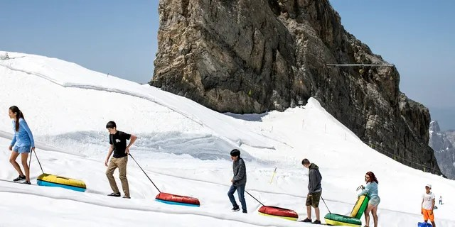 Tourists enjoy the summer temperatures on the Titlis mountain, on Wednesday, June 26, 2019, near Engelberg, Switzerland. All over Europe is hit by a heatwave.