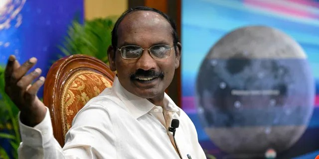 Indian space scientist and Chairman of the Indian Space Research Organization (ISRO), Kailasavadivoo Sivan, gestures as he speaks during a press conference at the ISRO headquarters Antariksh Bhavan in Bangalore on June 12, 2019.