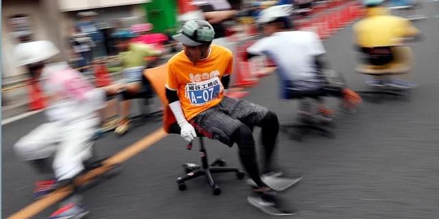 Racers compete in an office chair race in Hanyu, Japan, on Sunday.
