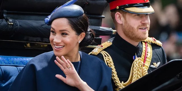 Prince Harry, Duke of Sussex and Meghan, Duchess of Sussex, ride the carriage in the mall during Trooping The Color