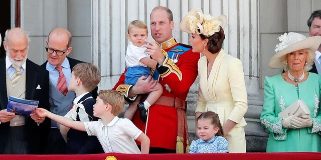 Britain's Prince William and Kate, the Duchess of Cambridge with their Prince George, center left, Princess Charlotte, center right, and Prince Louis, top center, attend the annual Trooping the Colour Ceremony