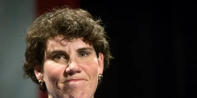 In this Nov. 6, 2018 photo, Amy McGrath speaks to supporters in Richmond, Ky. McGrath, a Marine combat aviator who narrowly lost a House race to an incumbent Republican in Kentucky, has set her sights on an even more formidable target: Senate Majority Leader Mitch McConnell. (AP Photo/Bryan Woolston, File)