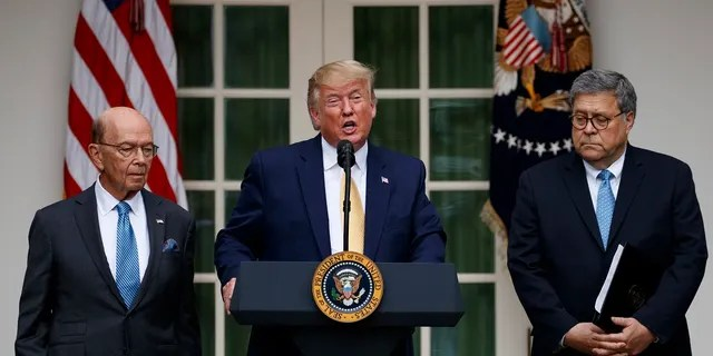 President Trump, joined by Commerce Secretary Wilbur Ross, left, and Attorney General William Barr, speaks during an event about the census in the Rose Garden this month. (AP Photo/Carolyn Kaster)