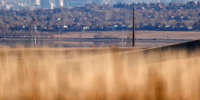 The Denver skyline is visible from the prairies in the Rocky Flats National Wildlife Refuge.