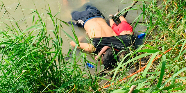 The bodies of Salvadoran migrant Oscar Alberto Martínez Ramírez and his nearly 2-year-old daughter Valeria lie on the bank of the Rio Grande in Matamoros, Mexico, Monday, June 24, 2019, after they drowned trying to cross the river to Brownsville, Texas. This photograph was first published in the Mexican newspaper La Jornada.