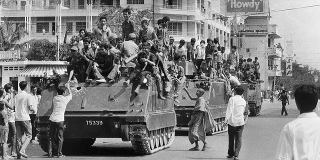 Khmer Rouge soldiers atop US-made armored vehicles in Phnom Penh, Cambodia, in April 1975. (SJOBERG/AFP/Getty Images, File)