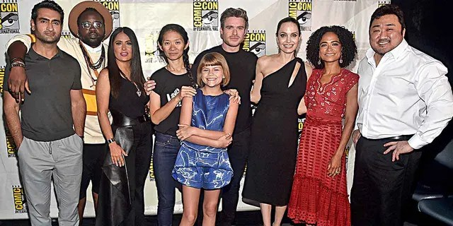 "Kumail Nanjiani, Brian Tyree Henry, Salma Hayek, director Chloe Zhao, Lia McHugh, Richard Madden, Angelina Jolie, Lauren Ridloff and Don Lee of Marvel Studios' ""The Eternals"" pose for a photo at the San Diego Comic-Con International 2019 Marvel Studios Panel in Hall H on July 20, 2019."