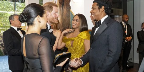 """Prince Harry and Meghan Markle greet Beyoncé and Jay-Z at the London premiere of """"The Lion King."""""""