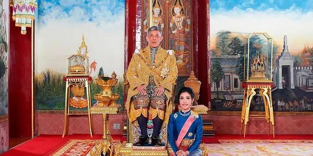 This undated photo posted Monday, Aug. 26, 2019 on the Thailand Royal Office website shows King Maha Vajiralongkorn with Major General Sineenatra Wongvajirabhakdi, the royal noble consort.
