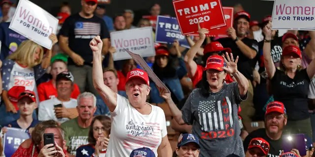 Supporters cheering at President Trump's campaign rally on Thursday.