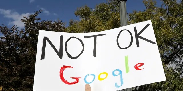 A Google employee holds a sign during a walkout to protest how the tech giant handled sexual misconduct in New York, Thursday, Nov. 1, 2018.