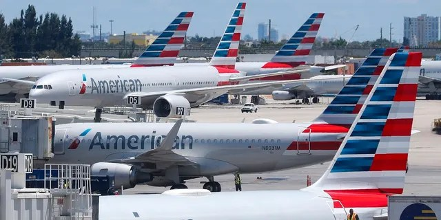 In this April 24, photo, American Airlines aircraft are shown parked at their gates at Miami International Airport in Miami. (AP Photo/Wilfredo Lee, File)