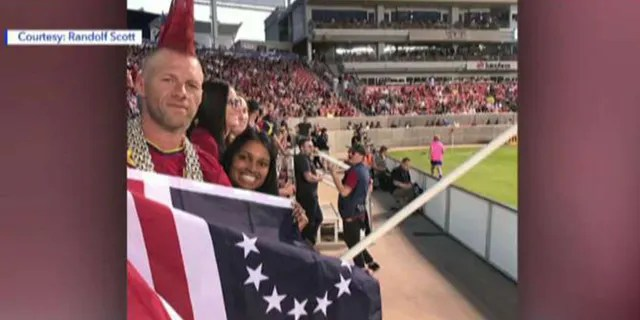 Randolf and Diana Scott at an RSL home game at Rio Tinto Stadium in Utah holding a Betsy Ross flag, before they put it away on the request of stadium personnel.