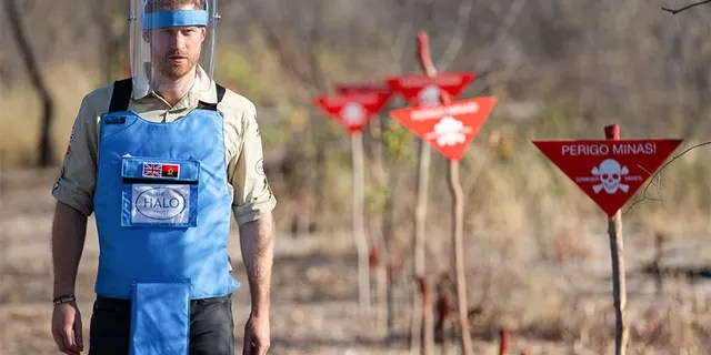 Prince Harry walks through a minefield during a visit to see the work of landmine clearance charity the Halo Trust in Dirico, Angola, on Sept. 27, 2019.