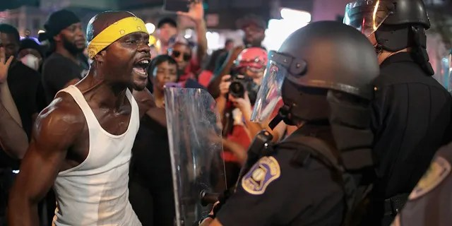 Demonstrators confront police while protesting the acquittal of former St. Louis Police Officer Jason Stockley in St. Louis in September 2017.