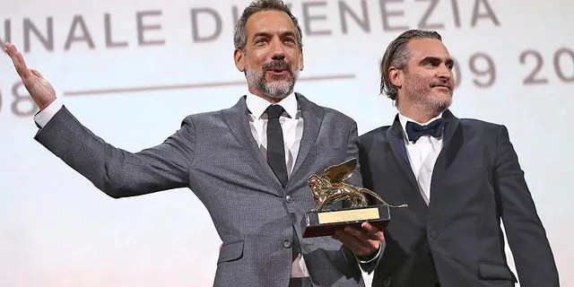 """Director Todd Phillips, left, holds the Golden Lion for Best Film for """"Joker,"""" joined by lead actor Joaquin Phoenix at the closing ceremony of the 76th edition of the Venice Film Festival in Italy back in September."""