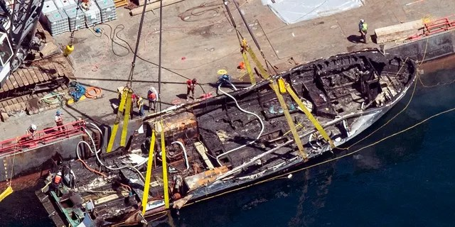 Te burned hull of the dive boat Conception. (Brian van der Brug/Los Angeles Times via AP, File)