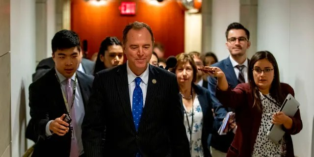 House Intelligence Committee Chairman Rep. Adam Schiff of Calif., leaves a secure area where Deputy Assistant Secretary of Defense Laura Cooper is testifying as part of the House impeachment inquiry into President Donald Trump, Wednesday, Oct. 23, 2019, on Capitol Hill in Washington. (AP Photo/Patrick Semansky)