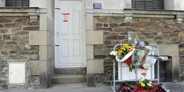 A picture taken on April 23, 2011 in the French city of Nantes shows messages and flowers left by local people on a metal barrier placed outside Dupont de Ligonnes' family home. (JEAN-SEBASTIEN EVRARD/AFP/Getty Images)