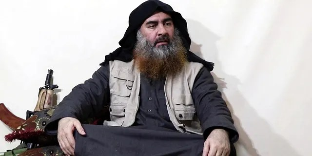 This file image made from a video posted on a militant website in April 2019 purportedly shows former ISIS leader Abu Bakr al-Baghdadi.