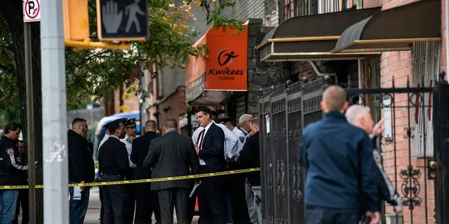 Authorities responded to a call about shots fired just before 7 a.m. and found four men dead in the Crown Heights neighborhood of Brooklyn at an address that corresponds to a private social club according to an online map of the street. A woman and two men suffered non-life-threatening injuries. (AP Photo/Jeenah Moon)