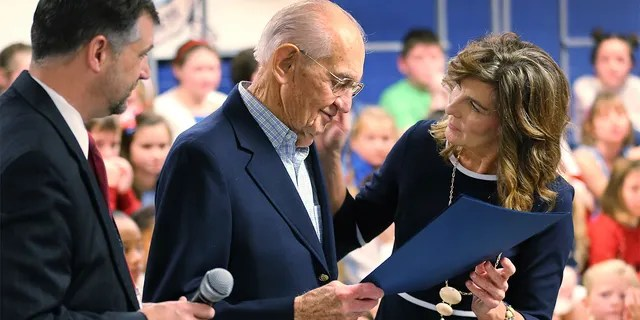 World War II veteran James Wallace Yarbrough, center, was presented an honorary diploma by school principal Lisa Thompson, right, and Hanover school superintendent Dr. Michael Gill, left.  (Dean Hoffmeyer/Richmond Times-Dispatch via AP)