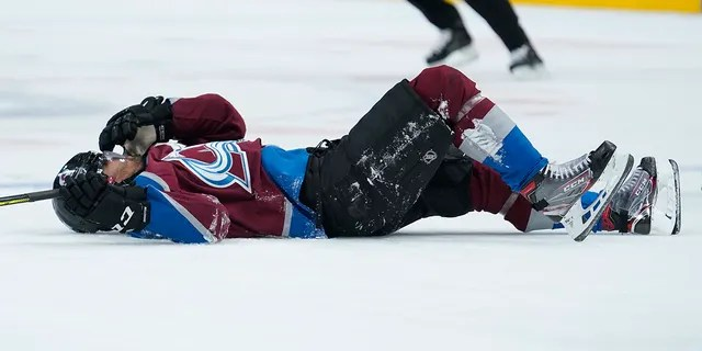 Colorado Avalanche left wing Pierre-Edouard Bellemare lies on the ice after being hit by Columbus Blue Jackets left wing Nick Foligno during the second period of an NHL hockey game, Saturday, Nov. 9, 2019, in Denver. (AP Photo/Jack Dempsey)