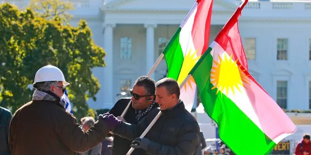 Demonstrators hold Kurdistan flags in front of the White House as thy protest Erdogan's visit Wednesday. (AP Photo/Steve Helber)