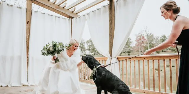 """""""Duncan decided pretty early on that he wanted to see me for the first time walking down the aisle with my father, rather thana 'first look.' In passing, we joked about me doing one with Zeke,"""" bride Kristen Dupree said."""