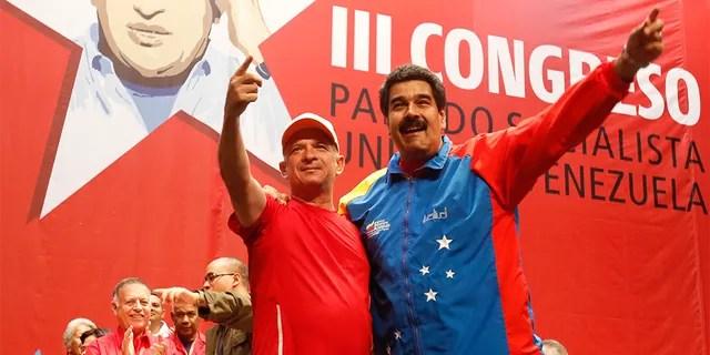 Venezuela's President Nicolas Maduro, right, embracing Hugo Carvajal at a Socialist party congress in Caracas, in July 2014.